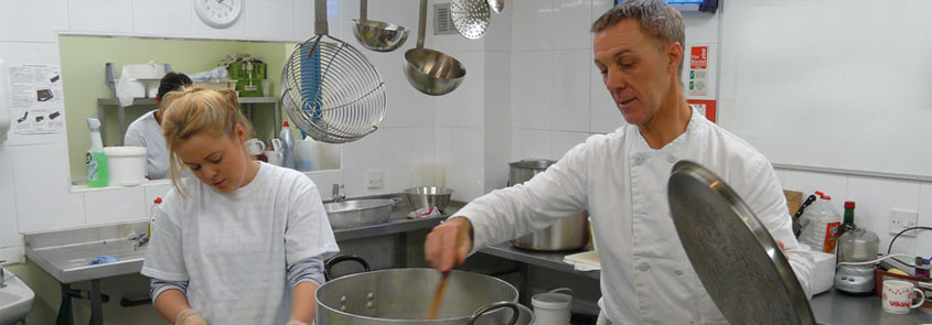 Chef at work in the kitchen at Caring at Christmas in Bristol